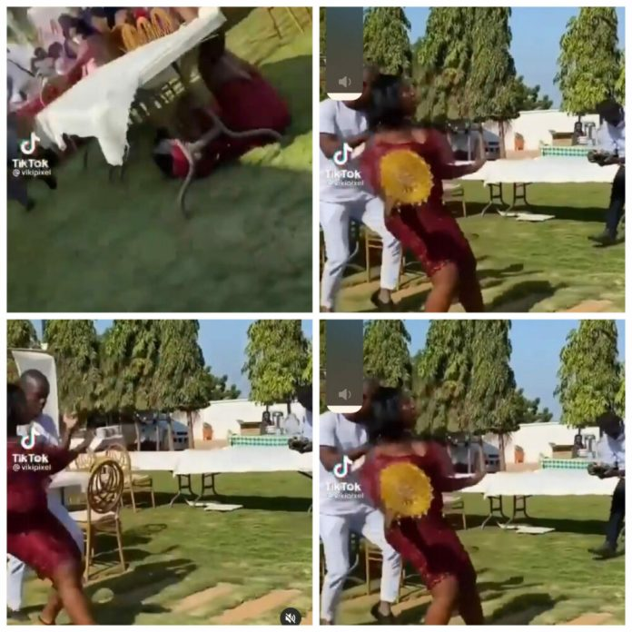 Yawa as Bridesmaid falls flat on the ground after she tried to showcase a 'killer' dance move (Video)
