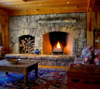 """Antique Granite, """"Dry-Fit"""", Arched Opening, Stone Mantel, Woodbox, Raised Granite Hearth"""