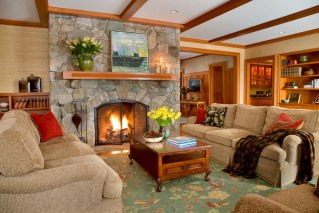 Fieldstone Mosaic, Arched Opening, Flush Flagstone Hearth, Designed Wooden Mantel w/ Stone Projections