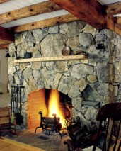 Fieldstone Mosaic, Arched Opening, Flush Flagstone Hearth, Designed Wood Mantel