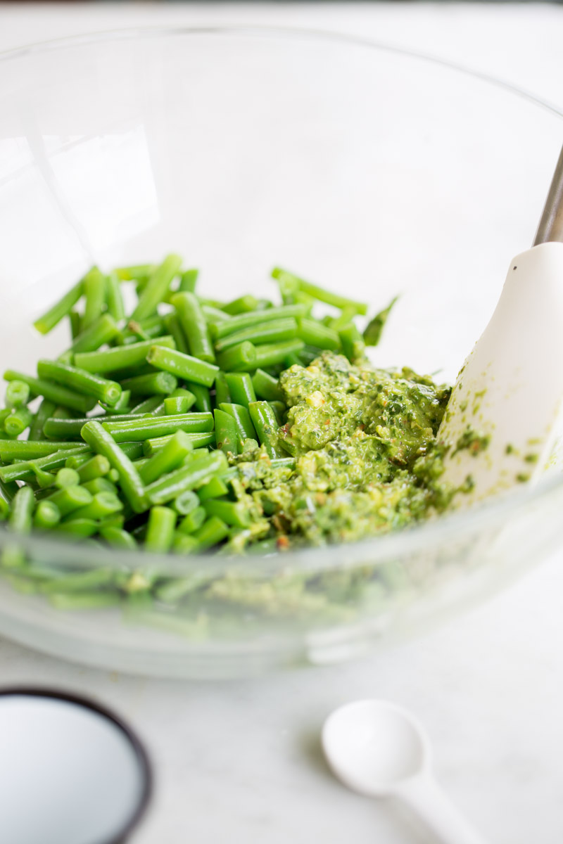 green beans and spicy almond pesto in a bowl