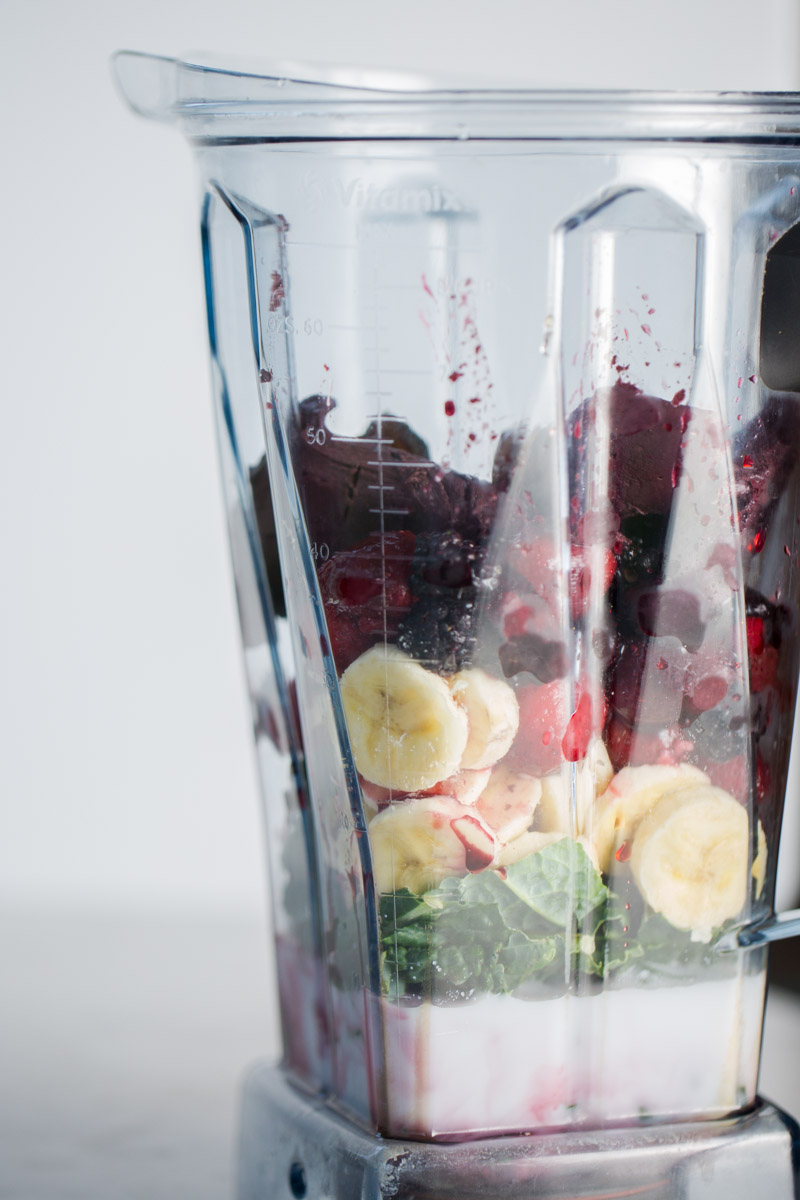 Ingredients for an incredible berries and acai smoothie in the blender