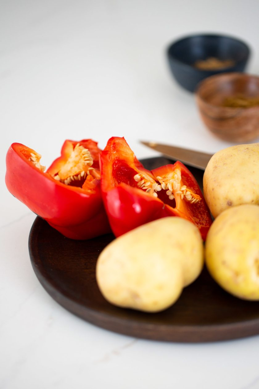 potatoes and red bell pepper cut in half
