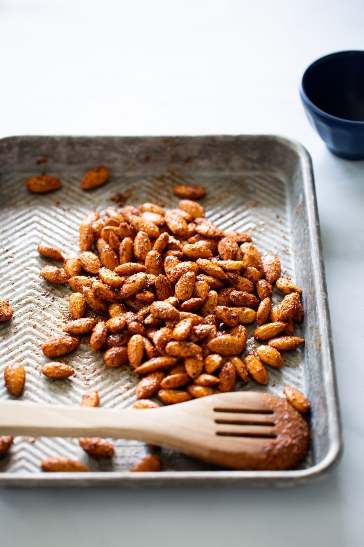 spicy vegan roasted almonds on a baking sheet