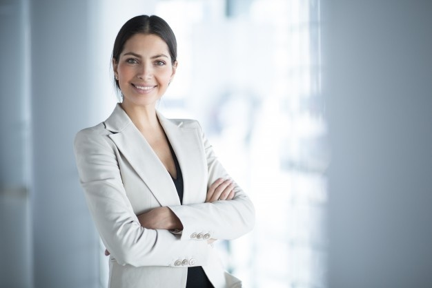 smiling-female-business-leader-with-arms-crossed_1262-3089_1555082714379.jpg