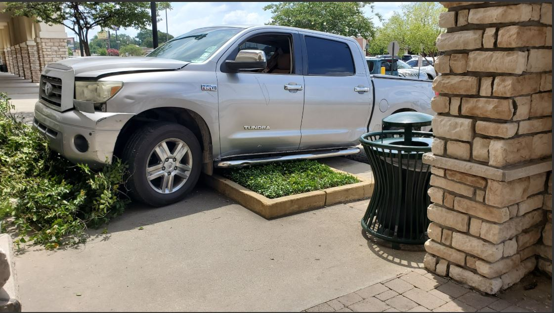 Pickup truck crashes near store on Airline Hwy