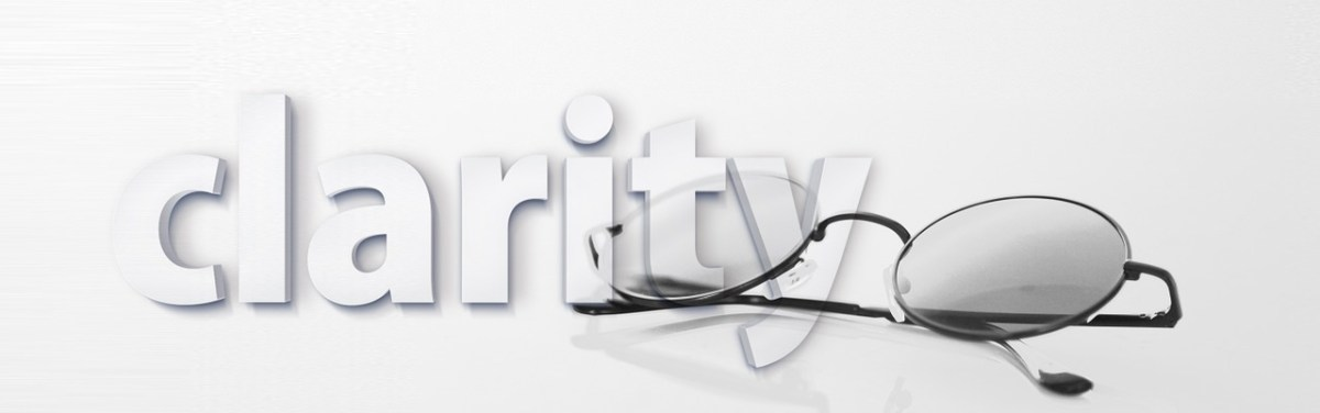 "White on white graphic with 3-D letters spelling clarity, with a pair of half-rim black glasses slightly overlapping word ""clarity."""