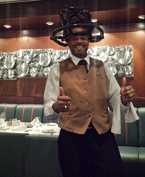 Waiter with balloon hat