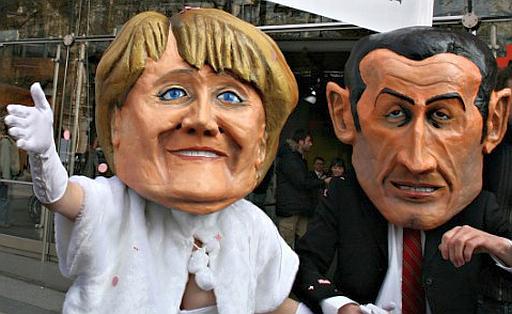 Lifesize puppets of Sarkozy and Merkel