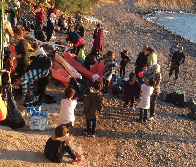 New arrivals to Europe in typical Lesbos beach scene