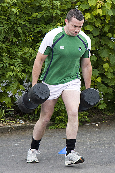 "The traditional ""Farmers Walk"" with two 8 Stone Weights."