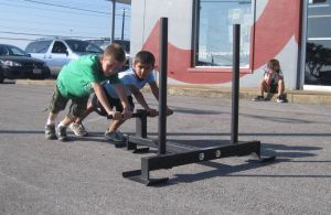 Crossfit Central kids push the butcher
