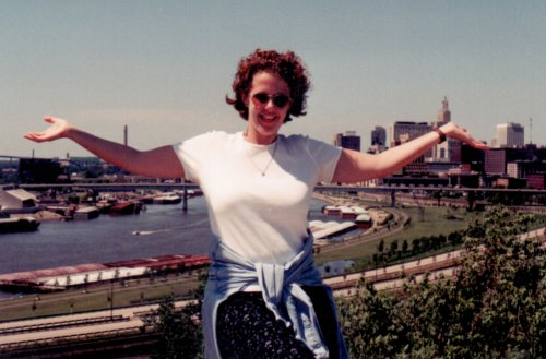 Cindy poses in front of the St. Paul skyline in 1997 or 1998.