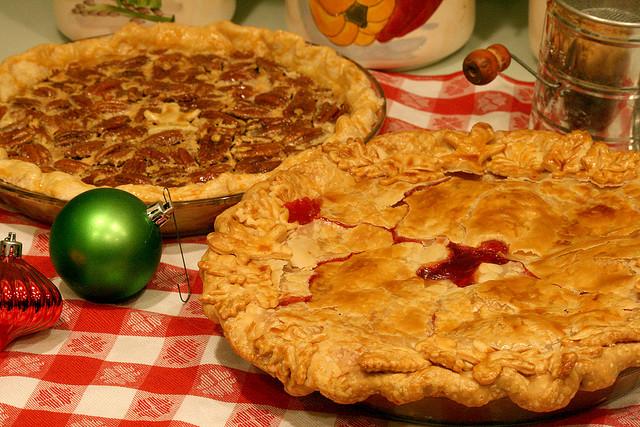 pecan pie and cherry pie on table