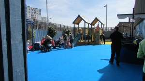 Toddlers group using outside play area on a sunny day.