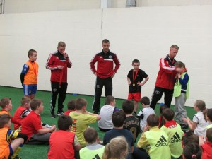 Young people receiving awards after completing the Jamie Carragher Half Term Soccer School.