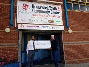 Steve Leggett Business Centre Manager Toyota Liverpool presenting cheque to Keith Lloyd Centre Manager Brunswick Youth and Community Centre