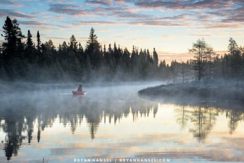 paddling a canoe on a foggy morning