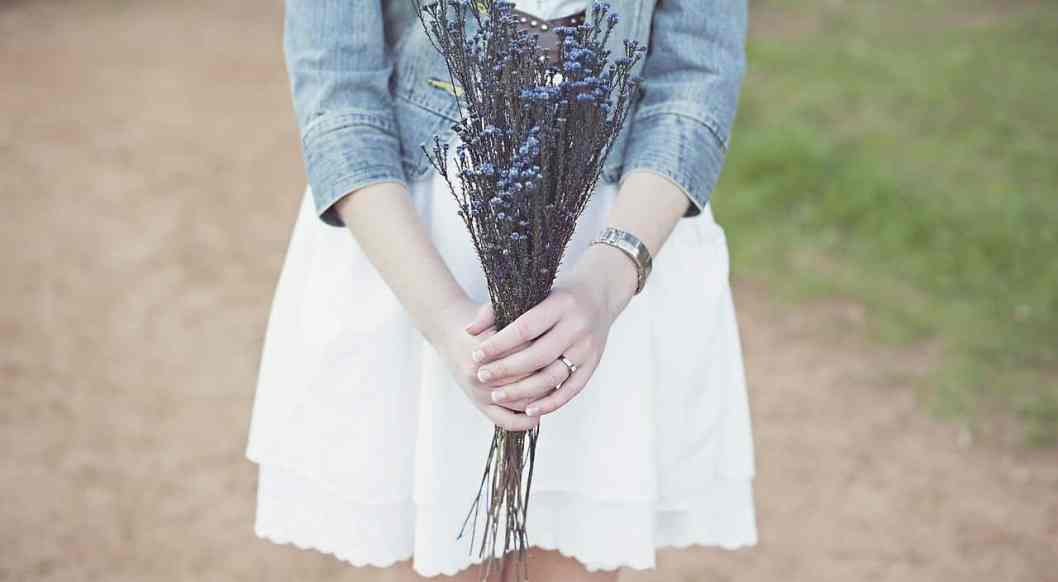 woman holding flowers should you date a godly woman you're not attracted to