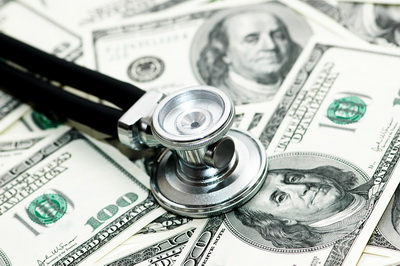 San Antonio Wrongful Death Attorney Medical concept - stethoscope over the dollar bills
