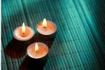 3 votive candles on a grass mat: POSITIVE AFFIRMATIONS FOR ANXIETY MANAGEMENT by Bryn Donovan, with positive affirmations for wealth, health, and more