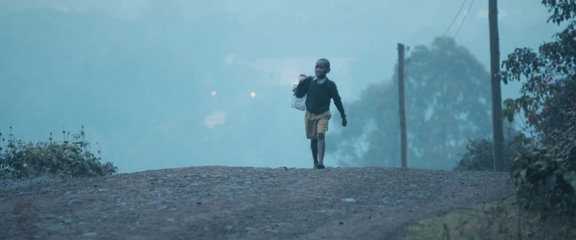 frame grab of a Kenyan child walking from the documentary Inspire Hope