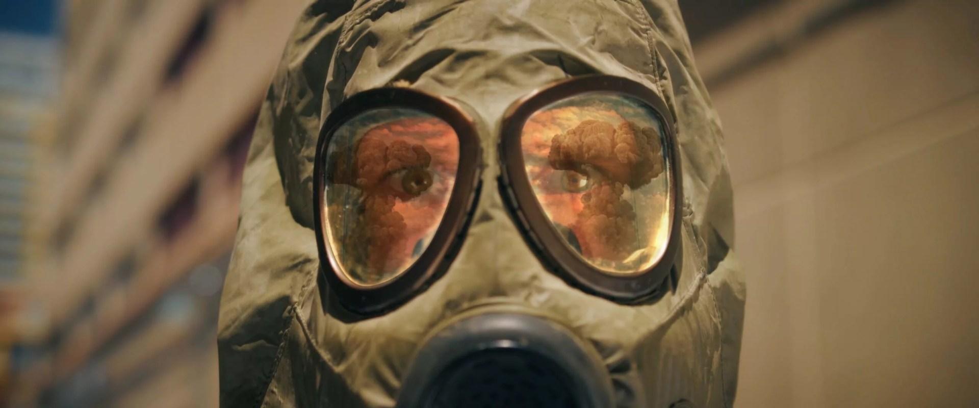 frame grab of man wearing gas mask