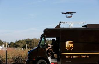 A drone demonstrates delivery capabilities from the top of a UPS truck during testing in Lithia, Florida, U.S. February 20, 2017. REUTERS/Scott Audette