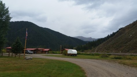 Small cabins and covered wagon around the ranch in Hoback Canyon.