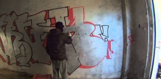 Un graffitaro in azione, foto da YouTube