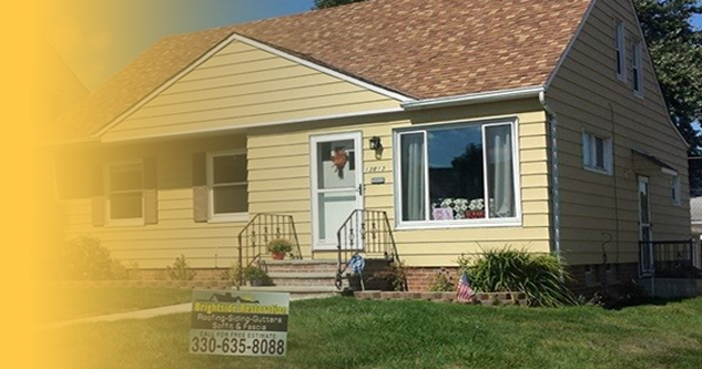 picture of a yellow house that brightside home restoration services in medina ohio put a brand new roof on with a yellow gradient from left to right