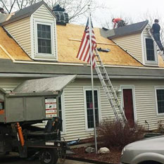 picture of brightside restoration doing some roofing services to a home in medina ohio