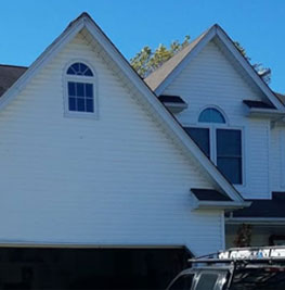 picture of a white houes that just got a fascia installation in medina ohio done by brightside restoration