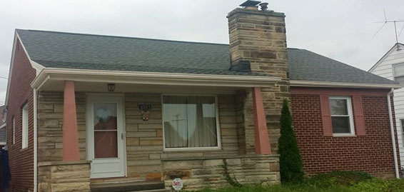 picture of brick house that had new gutters installed by brightside restoration gutter installation in medina ohio