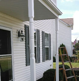 picture of a white house with green shutters that had a soffit installation in medina ohio job done by brightside restoration