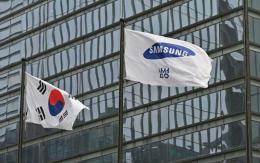 Samsung Electronics says Q2 operating profit to jump more than half