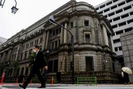 Bank of Japan revises down GDP forecast, details green fund