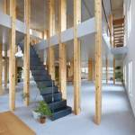 """In the office of the architectural company Mamiya Shinichi Design Studio (Japan) rows of wooden columns supporting the ceilings to create the effect of a forest. Outside, the building looks absolutely normal, but inside is a platform located at different heights. Platform supported by wooden columns resembling trees, hence the name of the building - Pillar Grove (""""the Grove of columns""""). According to the architects, their goal was to """"create the appearance of open space, which would play a key role in the development of the company and encourage communication between employees, and was also exploring the possibilities of wooden construction"""". Administrative and technical supervision of construction is the key to your peace of mind and full control of the situation. Fully open space shared only 30 wooden columns. The columns are arranged in rows from the outer walls to the center. They support various shapes of a plate on which there are jobs. """"This is a very unusual place, which creates the feeling of being in the woods. The picture is completed by the sunlight coming through the Windows,"""" say the designers."""