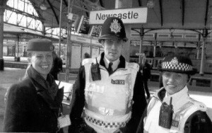 The author's present day successors on duty at Newcastle Central, with a member of station staff, in 2009.