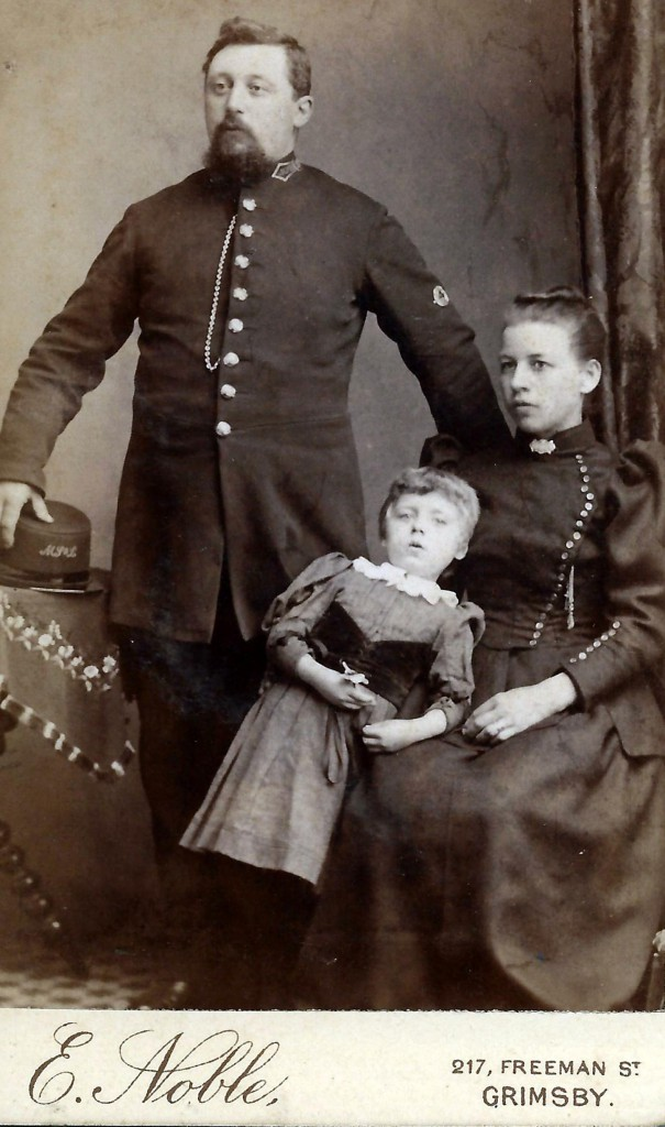 Reuben William Miller with wife Emma and child.