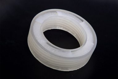 Detail photo of a ring shaped noise cancellation device built using an acoustic metamaterial both developed by Boston University engineers.