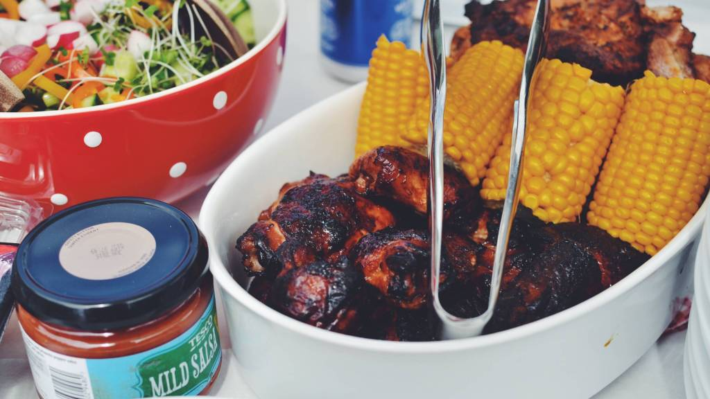 bbq cookout with salad, ribs and corn on the cob