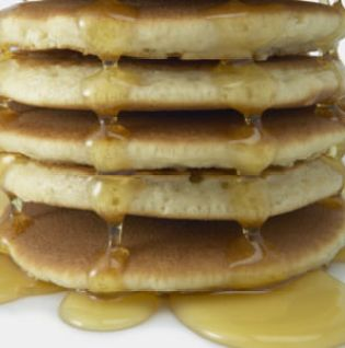 Stack of Pancakes with Syrup --- Image by © Royalty-Free/Corbis