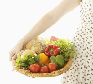 Woman with Basket of Food