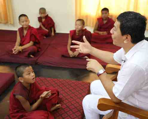 Juan Ruiz Naupari with Children Monks in a Pneuma Breathwork in Gaden Shatse Monastery