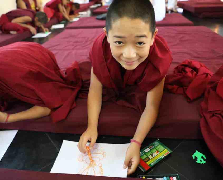 Child Monk after Pneuma Breathwork in Gaden Shatse Monastery