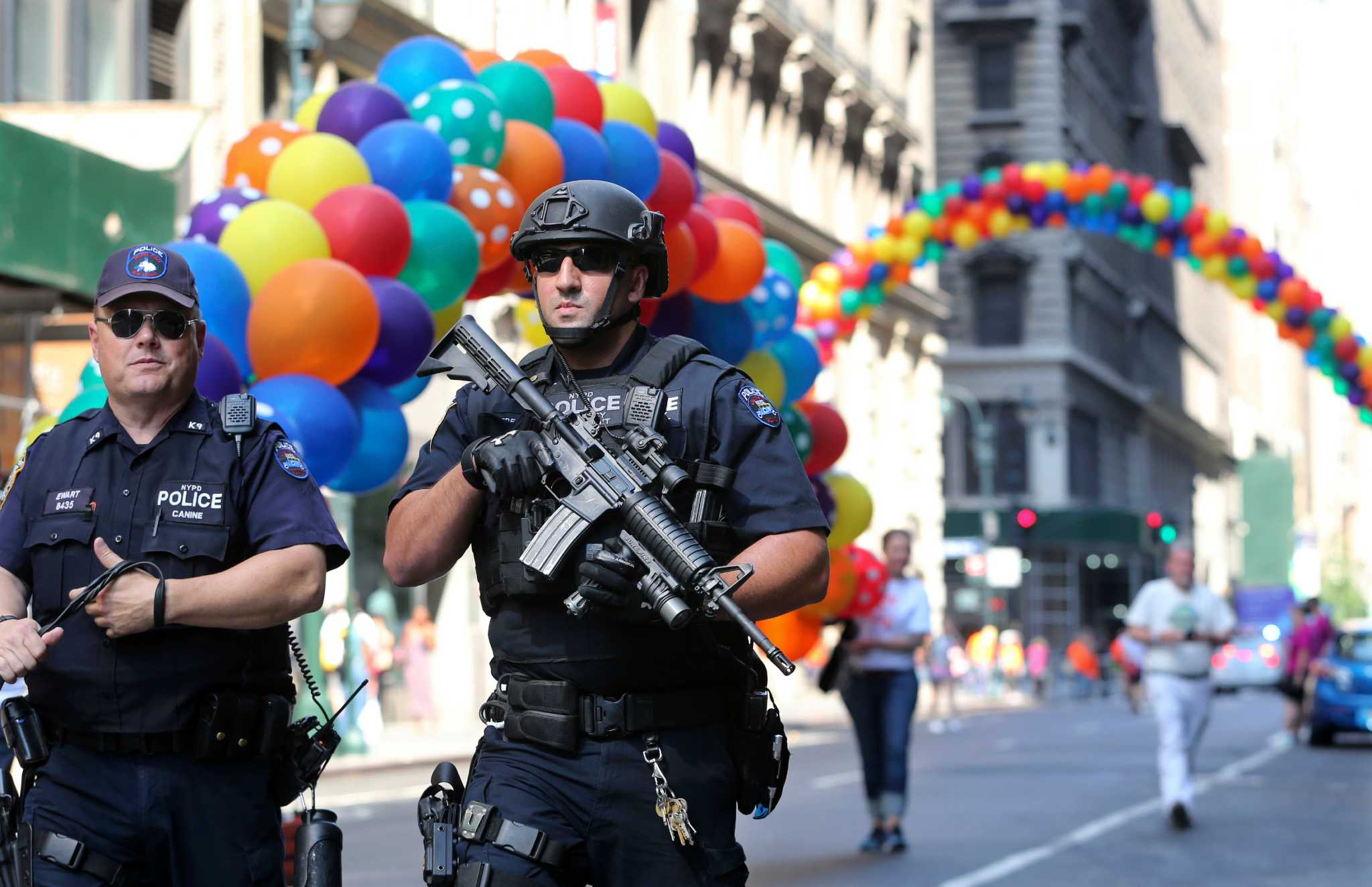Heavily armed police patrol a Pride event in San Antonio, TX. Photo by Ashlee Rezin/Chicago Sun-Times via AP.
