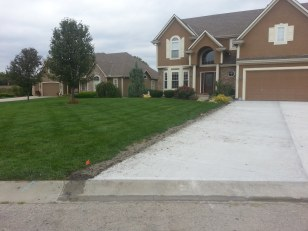 Repair work to the lawn and irrigation, from driveway replacement.