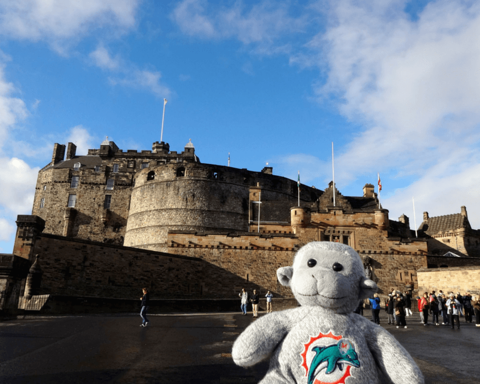 Buddy in front of the Edinburgh Castle, one of the fun things to do in Edinburgh
