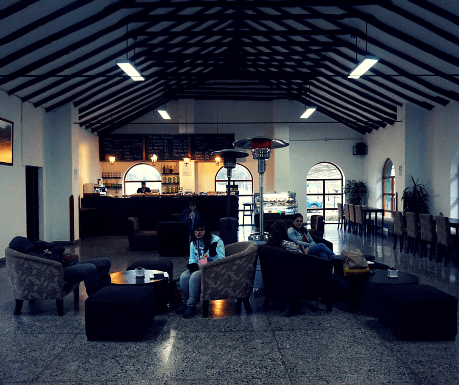 Inside the Poroy train station, small cafe, seats.
